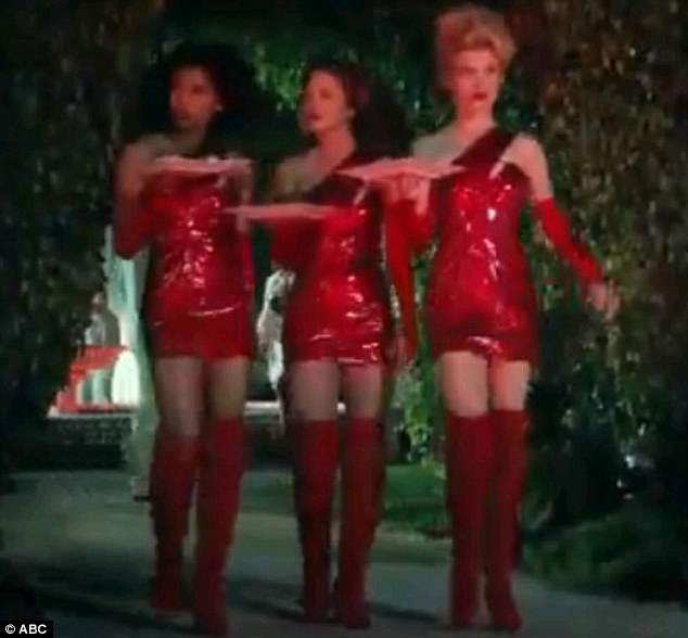 Better than ever: The girls wear a series of sexy outfits in the teaser trailer, including these shiny red dresses and matching boots
