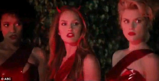 Devilish: Minka sports devil horns to go with her all-red outfit as the girls arrive for a job